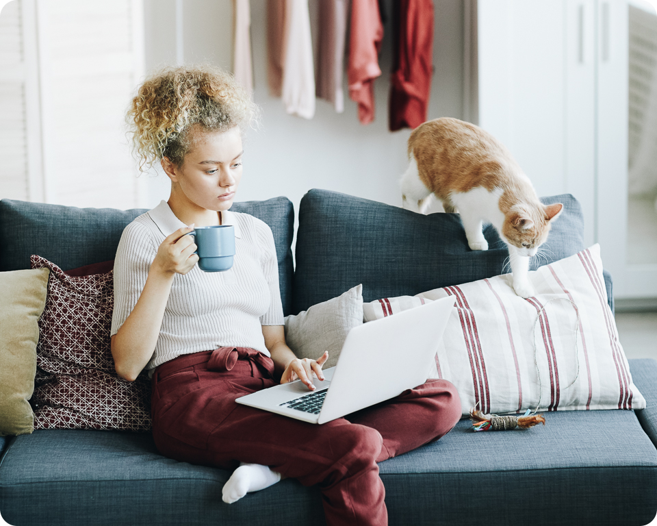 woman-with-laptop-at-home-P23H6YN